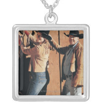 Portrait of a Cowboy and Cowgirl Arranging Reins Silver Plated Necklace