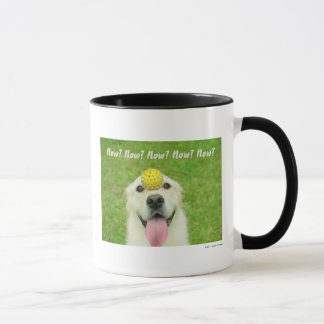 Portrait of a dog with a ball on its nose mug