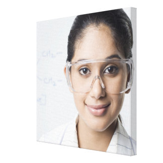 Portrait of a female lab technician wearing a stretched canvas prints