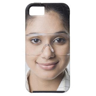 Portrait of a female lab technician wearing a iPhone 5 case