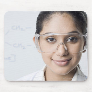 Portrait of a female lab technician wearing a mouse pad