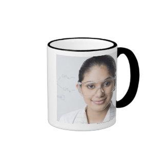Portrait of a female lab technician wearing a ringer mug