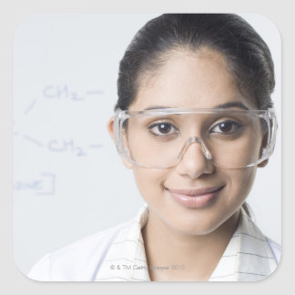 Portrait of a female lab technician wearing a square sticker