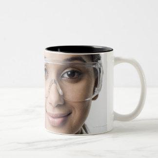 Portrait of a female lab technician wearing a Two-Tone coffee mug