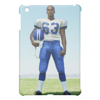 portrait of a football player holding a football cover for the iPad mini