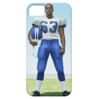 portrait of a football player holding a football iPhone 5 cases