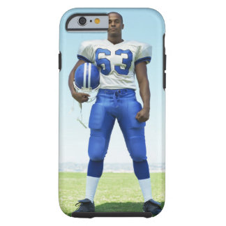 portrait of a football player holding a football iPhone 6 case