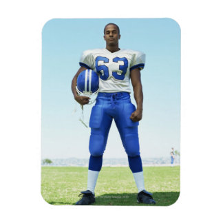 portrait of a football player holding a football magnet