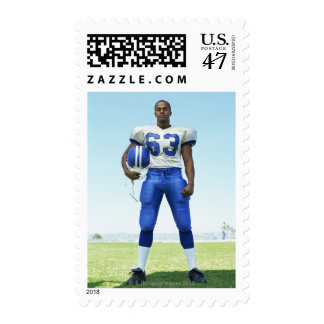 portrait of a football player holding a football stamp