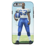 portrait of a football player holding a football tough iPhone 6 case