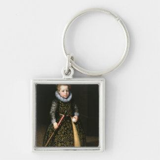 Portrait of a four-year old boy with club and keychain