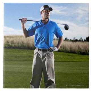 Portrait of a golfer on a sunny day. tiles
