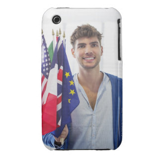 Portrait of a man holding flags of various iPhone 3 cover