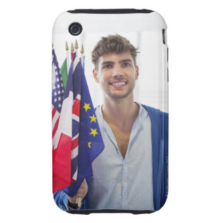 Portrait of a man holding flags of various iPhone 3 tough cover