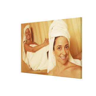 Portrait of a mature woman smiling with another canvas print