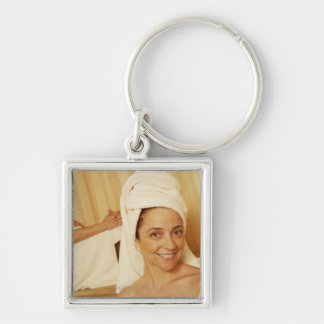 Portrait of a mature woman smiling with another key chains