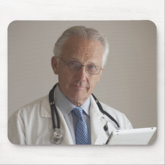 Portrait of a medical doctor holding a digital mouse pad