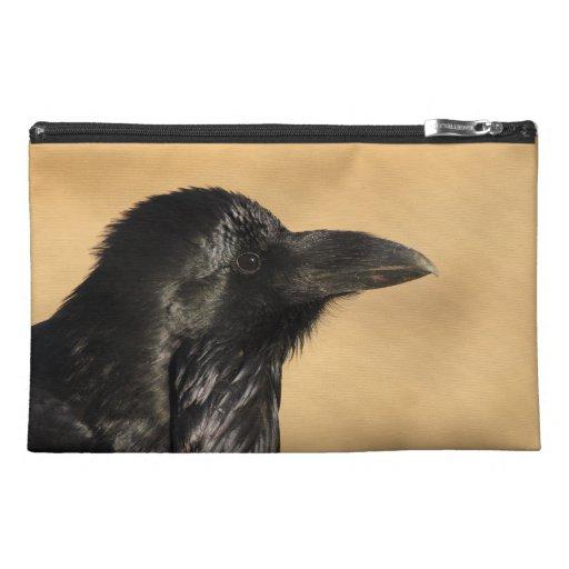 Portrait of a raven travel accessory bag
