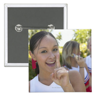 Portrait of a Teenage Cheerleader Holding a Button