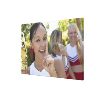 Portrait of a Teenage Cheerleader Holding a Canvas Print