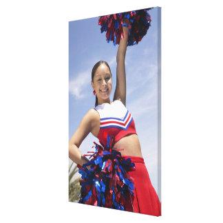 Portrait of a Teenage Cheerleader Holding Canvas Print