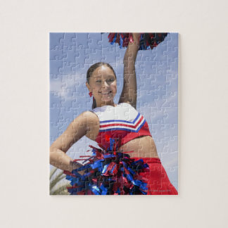 Portrait of a Teenage Cheerleader Holding Jigsaw Puzzle