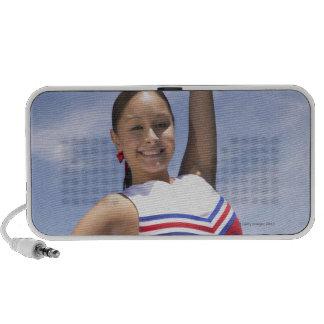Portrait of a Teenage Cheerleader Holding Speakers