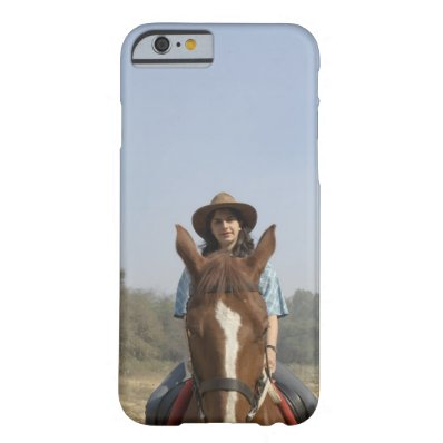 Portrait of a teenage girl riding a horse barely there iPhone 6 case