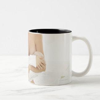 Portrait of a woman breastfeeding a baby (3-6 Two-Tone coffee mug
