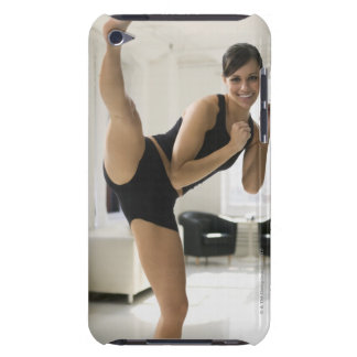 Portrait of a woman kicking barely there iPod cover