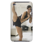 Portrait of a woman kicking iPod touch cover