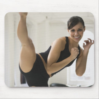 Portrait of a woman kicking mouse pad