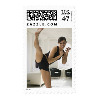 Portrait of a woman kicking postage stamp