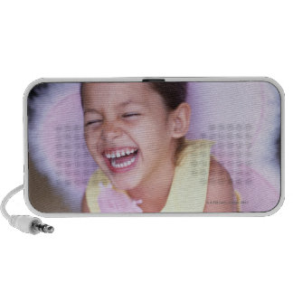 portrait of a young girl (6-8) dressed as an portable speaker