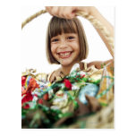 portrait of a young girl holding up a basketful postcard