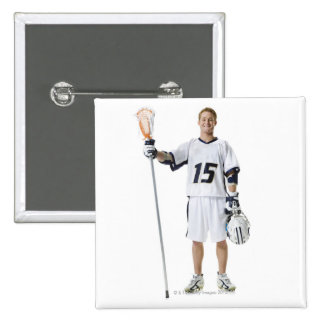 Portrait of a young man holding a lacrosse stick buttons