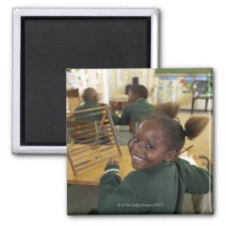 Portrait of a young schoolgirl smiling, KwaZulu Magnet