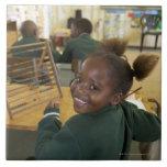 Portrait of a young schoolgirl smiling, KwaZulu Ceramic Tile