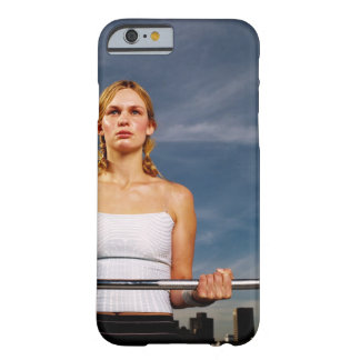 Portrait of a young woman carrying a barbell barely there iPhone 6 case