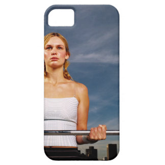 Portrait of a young woman carrying a barbell iPhone SE/5/5s case