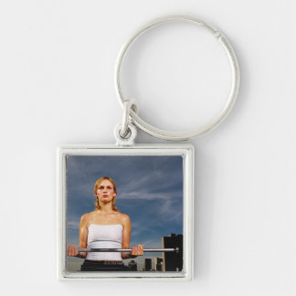 Portrait of a young woman carrying a barbell keychain
