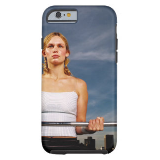Portrait of a young woman carrying a barbell tough iPhone 6 case