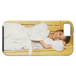 Portrait of a young woman lying in a sauna iPhone SE/5/5s case