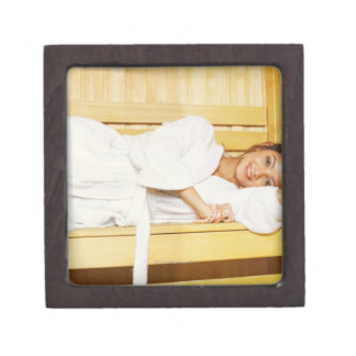 Portrait of a young woman lying in a sauna keepsake box