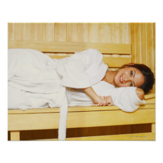 Portrait of a young woman lying in a sauna poster