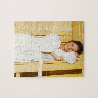 Portrait of a young woman lying in a sauna jigsaw puzzle