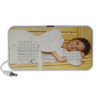 Portrait of a young woman lying in a sauna mp3 speaker