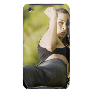 Portrait of a young woman practicing martial barely there iPod case