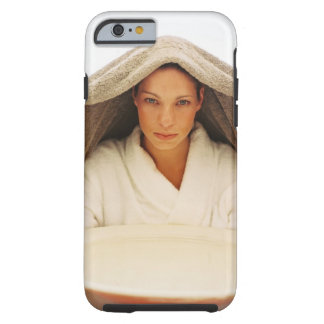 portrait of a young woman with a towel over her tough iPhone 6 case