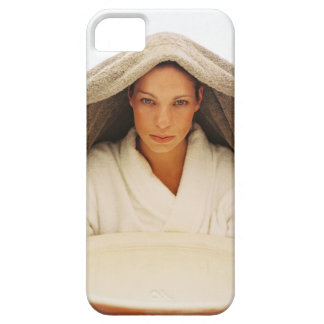portrait of a young woman with a towel over her iPhone 5 cases